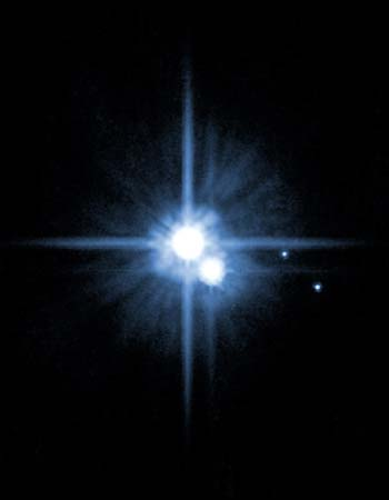 Pluto and its moons - photo courtesy of the AP