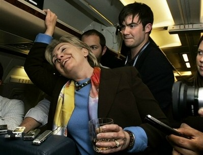Hillary enjoys a drink