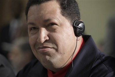 "Venezuela's President Hugo Chavez smiles after handing President Barack Obama the book titled ""The Open Veins of Latin America"" by Uruguayan writer Eduardo Galeano,  during a UNASUR countries meeting at the Summit of the Americas on Saturday, April 18, 2009 in Port-of-Spain, Trinidad and Tobago.  (AP Photo/Evan Vucci)"