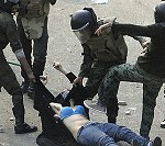 Egyptian woman being beaten