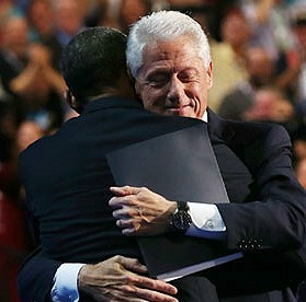 Pres. Obama and Bill Clinton hug